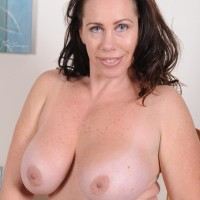 Mature dark-haired gal revealing gigantic natural tits and large bum