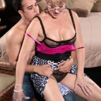 Experienced gal Tracy Licks has her giant breasts exposed for nip licking in glasses