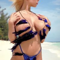 Notorious sandy-haired X-rated actress Tiffany Towers flashing hooters outdoors on beach