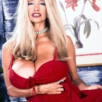 Famous older X-rated film starlet Alexis Enjoy lets her huge breasts free in hosiery