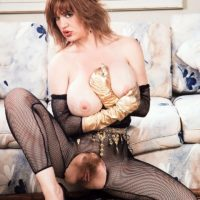 Prominent XXX film star Ashley Bust discards her monster-sized tits from crotchless bodystocking