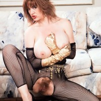 Notorious XXX flick star Ashley Unload discards her giant fun bags from crotchless body-stocking