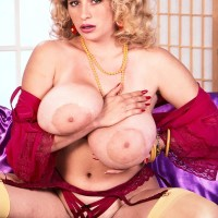 Well-known pornostar Crystal Topps lets out her monster-sized tits in nylons and garters