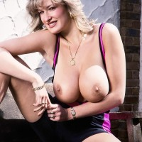 Notorious adult movie star Debbie Q sets her great boobies free of a cock-squeezing sundress in solo activity