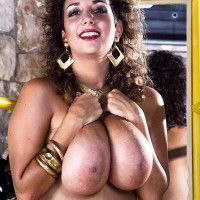 Prominent XXX actress Devon Daniels flaunts her enormous breasts attired black tights