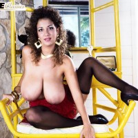 Notorious XXX film star Devon Daniels flaunts her large breasts garbed ebony stockings