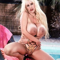 Prominent adult film star Honey Moons uncovers her gigantic juggs from her bikini top