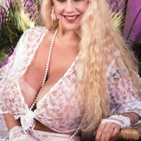 Notorious XXX vid star Honey Moons unleashes her huge titties outdoors in garters and nylons