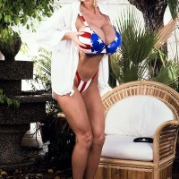 Prominent adult film starlet Pandora Peaks whips out her hefty boobies from a USA themed bikini