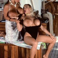 Well-known X-rated film starlet Tawny Peaks and lesbian girlfriend loose hefty boobies from bathing suits on boat