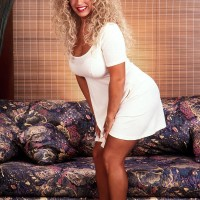 Legendary adult film star Taylor Marie lets out her massive knockers in a milky dress and lingerie