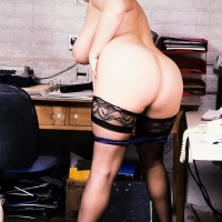 Well-known porno starlet Toni Evans reveals her enormous knockers and massive booty from uniform in stockings