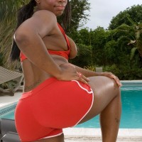 Overweight black female Keyona Kay lubricating up uber-sexy humungous ass outdoors by swimming pool