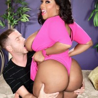 Overweight ebony chick Ms Juicy strangles a dude with her monster-sized knockers after showing off her butt