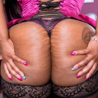 Plus-size black babe Virgin Blossoms displaying immense ass in stockings and lingerie