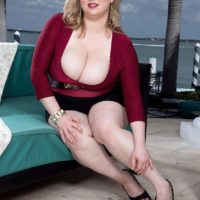 Over weight light-haired female Laddie Lynn flashes her upskirt underwear along with her ample bosom