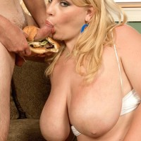 Over weight light-haired female Scarlett Rouge tonguing food while engaging in blowjob activities