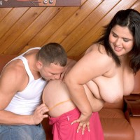 Plus-sized dark haired Karla Lane seducing stud for a hard banging on leather chesterfield