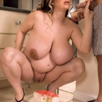 Plus size female April McKenzie showcasing hefty fun bags while slurping rod and gobbling food