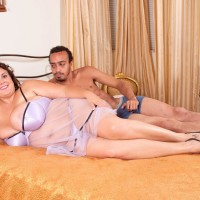 Obese female Charlie Cooper delights her stud with her giant titties in transparent lingerie
