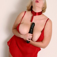 Plus sized aged blond with massive all-natural boobies masturbating pussy with big dildo