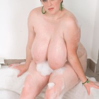 Plus sized babe Alice Webb letting gigantic moist boobs suspend loose in the bathtub