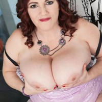 Obese solo female Roxee Robinson letting her gigantic all-natural tits loose from dress in pumps