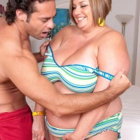 Obese woman Kendra Mercy finger opens up her cunny before her guy tongues her hard nipples