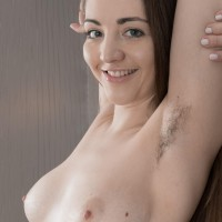 Lithe amateur model Virgin Bloom showcases her unshaven underarms and unshaven cunt in the nude