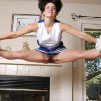 Supple chick doffs a cheerleader uniform before playing with her gash while nude