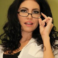 Glasses garmented brunette Emmanuelle London flashing her smoothly-shaven fuckbox in hose during upskirt action