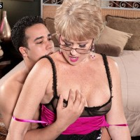 Glasses clad MILF over Fifty Tracy Slurps seducing junior boy with a hand-job