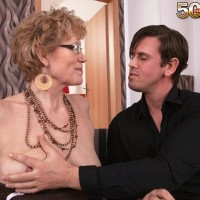 Grannie in glasses seduces a junior man and bj's his cock on couch