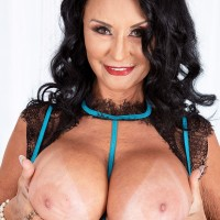 Grannie adult film star Rita Daniels unveils her massive titties before sucking and tugging a dildo