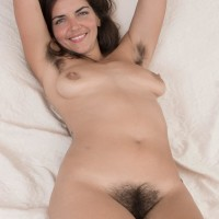 Hirsute brown-haired Katie Z strips off her bodysuit to make her naked modeling debut outdoors