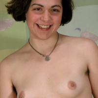 Hirsute European amateur with pierced swell nips stripping to pose in the nude
