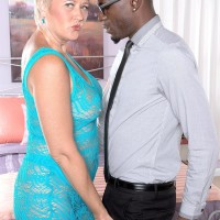 Dirty grandma Tracy Gobbles entices a junior ebony dude by flashing her immense all-natural boobies