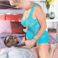Dirty granny Tracy Licks tempts a junior black guy by vaunting her hefty all natural melons