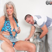 Super-sexy Sixty plus MILF Silva Foxx seduces a junior dude by flaunting her funbags in a denim microskirt