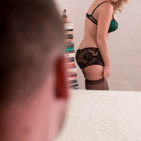 Enticing platinum-blonde cougar Cali Houston is liberated from seductive lingerie on a bed by her toy boy