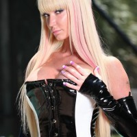 provocative fair-haired Domme Alexia Jordon rides a masked masculine submissive in latex by the pool