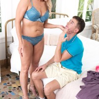 Seductive blonde granny Chery Leigh displays a younger dude while seducing him