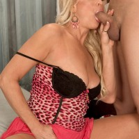 Cool sandy-haired grandma Natasha deep-throats on a BIG EBONY DICK after a seduction vignette in a mini-skirt
