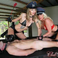 Sexy blondes Cherry Morgan and Alina top a masculine sub outdoors in latex fetish wear