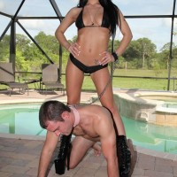 Mind-blowing dark-haired Adriana Lynn makes a collared male submit to her will in stiletto boots