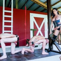 Seductive dark-haired authoritative type Dava FoXX manhandling and demeaning 2 male submissives