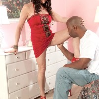 Sexy dark haired grandma Rita Daniels tempts a younger ebony man with her great legs