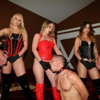 Wonderful females in spandex garment and hip high boots manhandle collared male subs by a pool