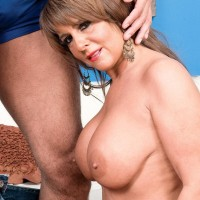 Beguiling grannie Cassidy has her large titties touched while a black boy unclothes her