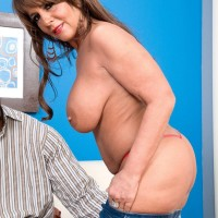 Gorgeous granny Cassidy has her big tits massaged while a ebony dude disrobes her